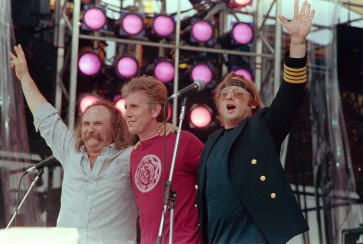 From left, David Crosby, Graham Nash and Stephen Stills, performing collectively as Crosby, Stills and Nash, acknowledge the crowd during the Live Aid concert for famine relief at JFK Stadium in Philadelphia, Pa. July 13, 1985.(AP Photo/Amy Sancetta)